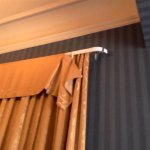 Curtains hanging off the rail