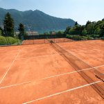 Tennis courts with lake view