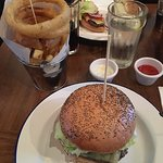 The burger with chips and onion rings.