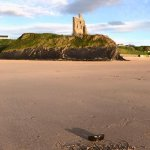 Ballybunion Castle remains and beach across from restaurant