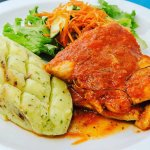 Bajan Style Fish served with garlic mashed potatoes and a side salad