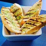 Garlic bread with a drizzle of pesto