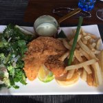 Delicious Tilapia fish in Panko crumbs with a fresh salad and crispy fries