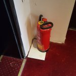 emergency instruction below the fire extinguisher facing the floor