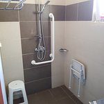 Accessible shower with shower seat, grab rails and lower shower head
