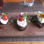 Burrata on Pumpernickel toast w/ herb pesto