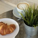 Dining outside with croissant and latte