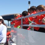 Kevin from the Science Centre and a boat full of young science enthusiasts