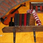 Violin with Books on Shelf