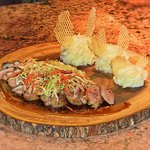 Seared Duck Breast in a tamarind sauce topped off with asian inspired coleslaw