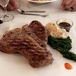 Porterhouse steak, bacon blue cheese mashed potatoes and broccolini. It was on special for $64.
