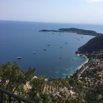 View from the terrace of the resaturant to the french riviera and steep cliffs surrounding it