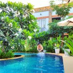 Our tropical green garden and swimming pool