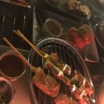 Satay, shrimp cakes and spring rolls