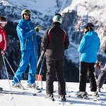 A Summit instructor taking his group down the Findeln piste.