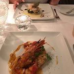 Tiger prawns flamed with cognac and lobster risotto and Flavored cod loin