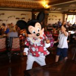 Mickey leading a parade around the restaurant
