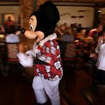 Mickey leading a parade around 'Ohana restaurant
