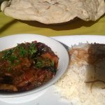 Tapsi - Aubergines, peppers & potato cooked in a spicy tomato sauce