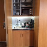 Kitchenette with tea/coffee, microwave, refrigerator, dishes, sink