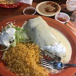 Shredded beef burrito and chicken/steak burrito both with cheese sauce ($1.00 extra charge for c