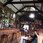 Far end of the bar