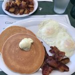 The Breakfast Sample (2 eggs, 2 bacon strips, 2 sausage links with 2 pancakes or french toast)