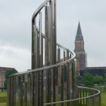 Kiel, view on the tower of the City Hall from and sculpture