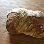 There were three types of home made loaves of bread available as well as baguettes.