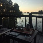 Sunrise on the Zambezi. Coffee tray delivered by staff!