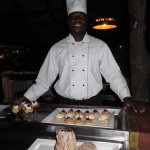 Crouther Dube and some of his desserts.