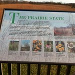 Info board in front of a prairie in this state park
