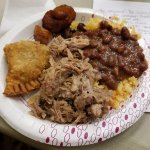 Rice and beans, pork, plantains, beef empanada