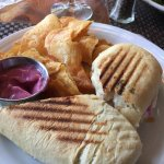 Turkey and Brie with Raspberry Mayonnaise on grilled panini w/chips