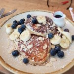 Delicious soft warm blueberry & banana waffle/pancakes with maple syrup.