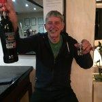 Graham with bottle of black sambuca