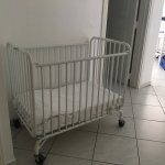 Portable crib -- very nice--not just a pack 'n play. We wove towels at the bottom to create a bu