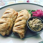 Sausage Rolls - puff pastry wrapped Flora Butcher bangers, house Pub Ale mustard, pickled onion