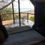 Looking out of the room to the private porch and the Chobe River valley below.