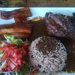 Carribean chicken with rice and plantains and salad