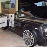 a Rolls Royce on display inside the BMW headquarters