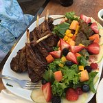 Lamb chops with a salad containing lots of fruit