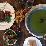 Steak, salad, side of fries and Mint pea soup