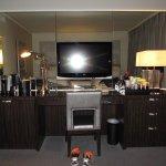 TV and Desk area, mini bar and snacks inside