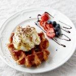 Belgian waffle with vanilla ice cream, caramel sauce and fresh berries