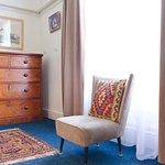 Bedroom, vintage furniture, contemporary art.