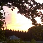 The setting sun from front porch of Speckled Hen Inn
