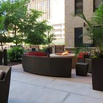 Patio area is behind hotel - away from street - nicely designed, clean and private
