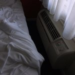 The bed is a few inches from the AC unit. Can barely get by. Non-adjustable louvers on the AC.