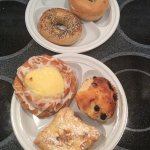 Sesame and plain bagel, blueberry muffin (slightly eaten),cream cheese danish and puffed pastry